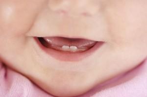 Первые молочные зубки